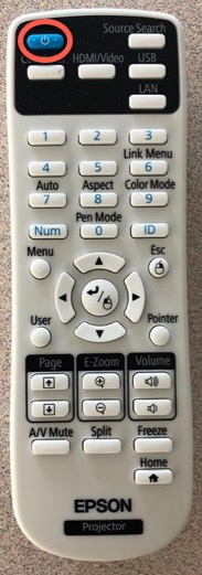 Projector Remote calling out the blue power button top left hand corner